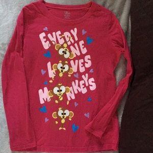 Children place girls shirt